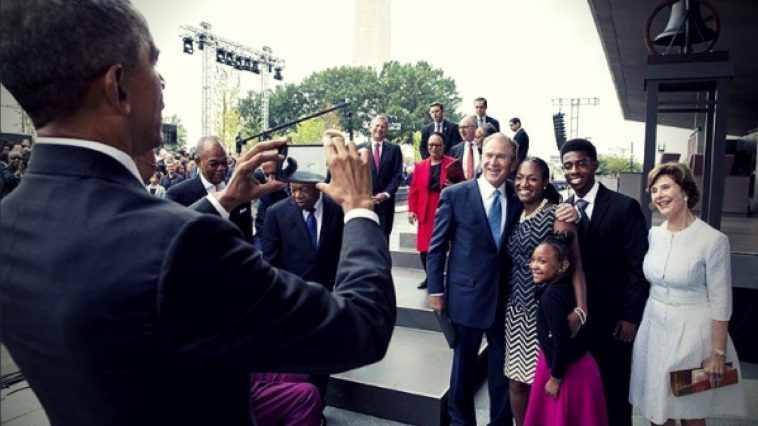 george bush takes a selfie with president obama